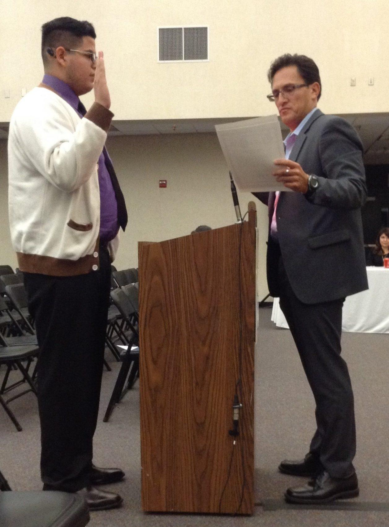 Lugo student gets awarded by President of Board.