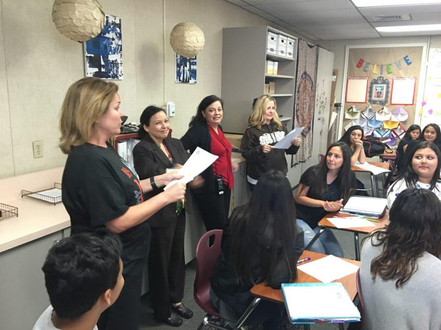 Dr.+Cabrera+and+the+administrative+team+visited+the+classrooms+of+the+key+teachers+who+helped+put+the+WASC+report+together.+Dr.+Cabrera+is+featured+here+reading+the+letter+from+WASC+in+Mrs.+Lord%27s+English+class.