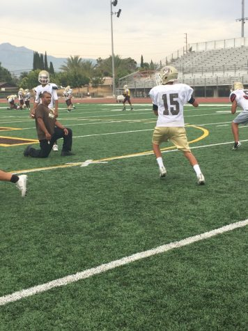 Marcos Melendez working on plays with during practice. The young quarterback continues to work to improve himself so he can be more than ready to start again.