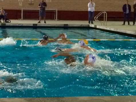 Don Lugo (dark caps) swimmers defending their goal at all cost. Josh Ibarra explained,