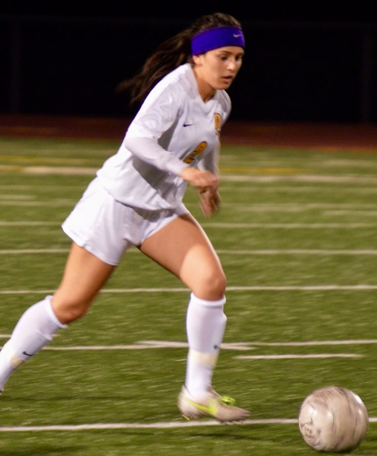 Alyssa Pedroza dribbles the ball to victory. Don Lugo varsity soccer girls start of their season strong. Photo taken by Johnny Palavecino.