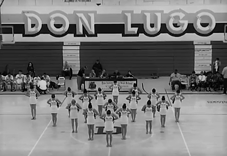 "The Don Lugo Dance team preforms at their first sports game with a ""Pom"" routine. The team is expected to be seen at more sports games throughout the year. This is a first of their many soon to come ""Pom"" routines."