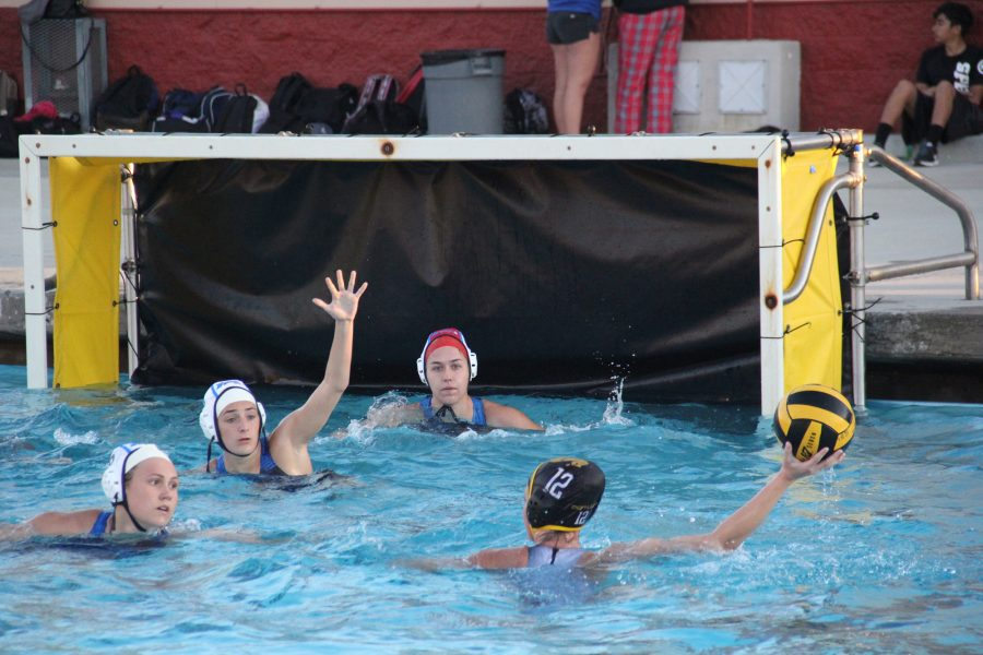 Lady Q's trying to defend their goal during the intense game. For some of the players, this is their first time in CIF. The Lady Q's are definitely looking forward to their next season!