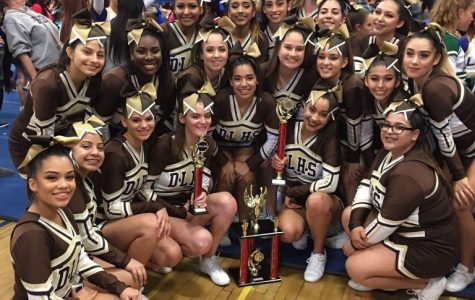 Cheer brings home the gold with a smile