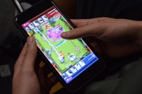 A Don Lugo student is seen watching a playback of a previous thrilling match. Clash Royale has many Lugo students hooked, creating a community among the 'clashers.' The app was named the Best Mobile Game of 2016 by multiple technology reviewers.