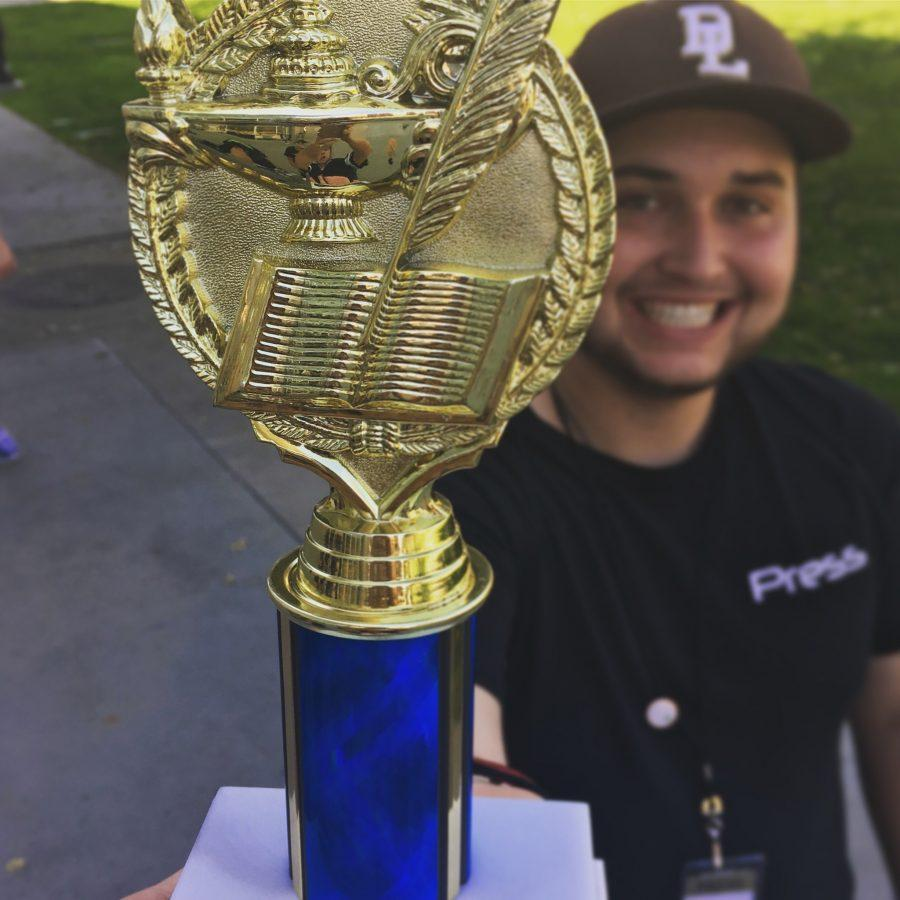 Chris+Cuadras%2C+Commentary+Reporter%2C+holds+the+official+sweep-stakes+trophy+which+recognizes+Quest+News+placing+third+for+most+awards.+Quest+News%27+second+competition+was+%22successful+practice%22+for+reporters+as+they+prepare+for+Nationals+in+three+weeks.+Photo+courtesy+of+Advisor%2C+Mrs.+Deming.