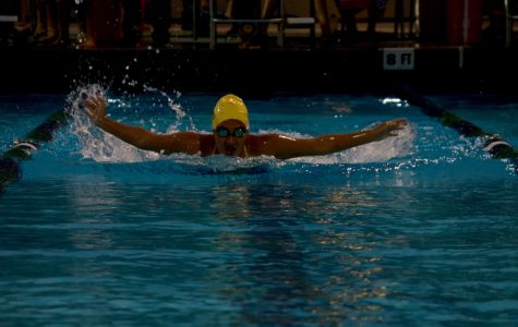Don Lugo competes in Cowbell: a four school swim tournament