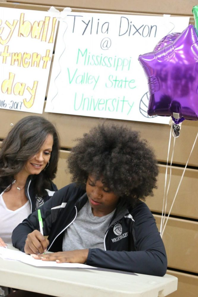 Don Lugo's volleyball superstar Tylia Dixon anxiously signing her letter of intent to MVSU with varsity coach Eve Knowles by her side.
