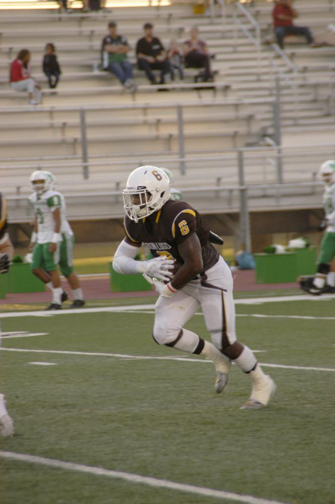 Khoury Bethley with the ball in his hands making his way to the end zone.