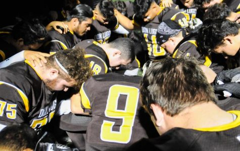 Conquistadores Take a Knee Before The Biggest Game In 38 Years