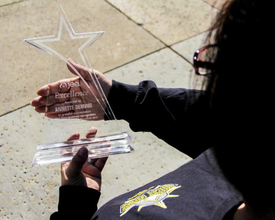 Quest+News+adviser%2C++Annette+Deming%2C+won+the+Rising+Star+award+during+her+trip+to+Dallas.+Photo+courtesy+of+Daniel+Pahutan.