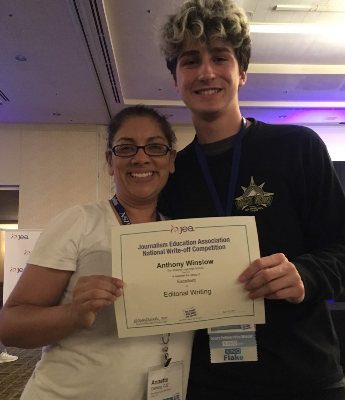Adviser%2C+Annette+Deming%2C+CJE+congratulates+Anthony+Winslow+on+his+second-place-category+Excellent+Award+in+Editorial+Writing.