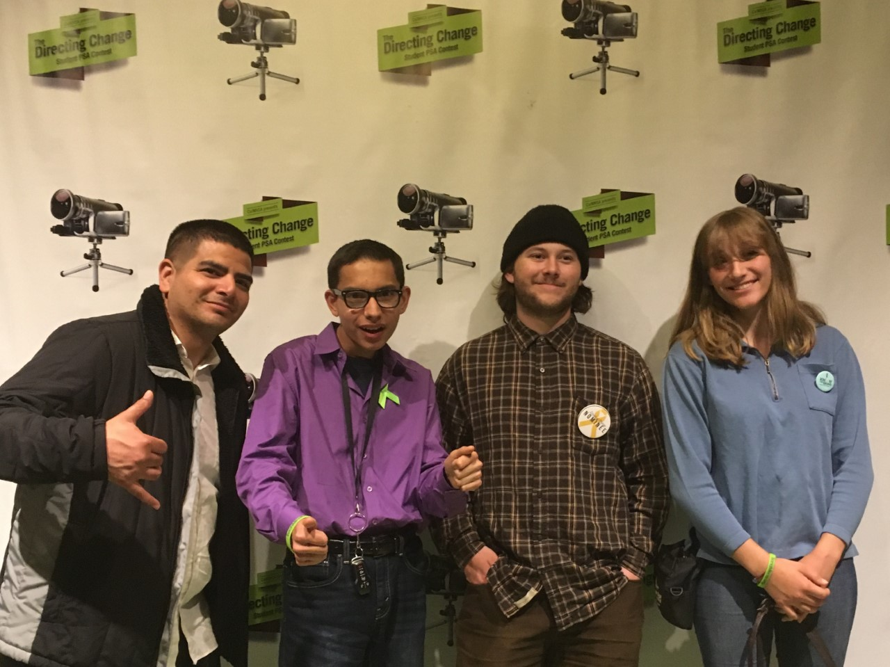 Digital Video Adviser, Brian Garcia, and students Aiden Deming, Jake Swartz, and Student Director, Shaiyanne Leeming pose at the California Performing Arts Theatre for the 6th Annual Inland Empire Screening & Award Ceremony of the Directing Change Film Contest.