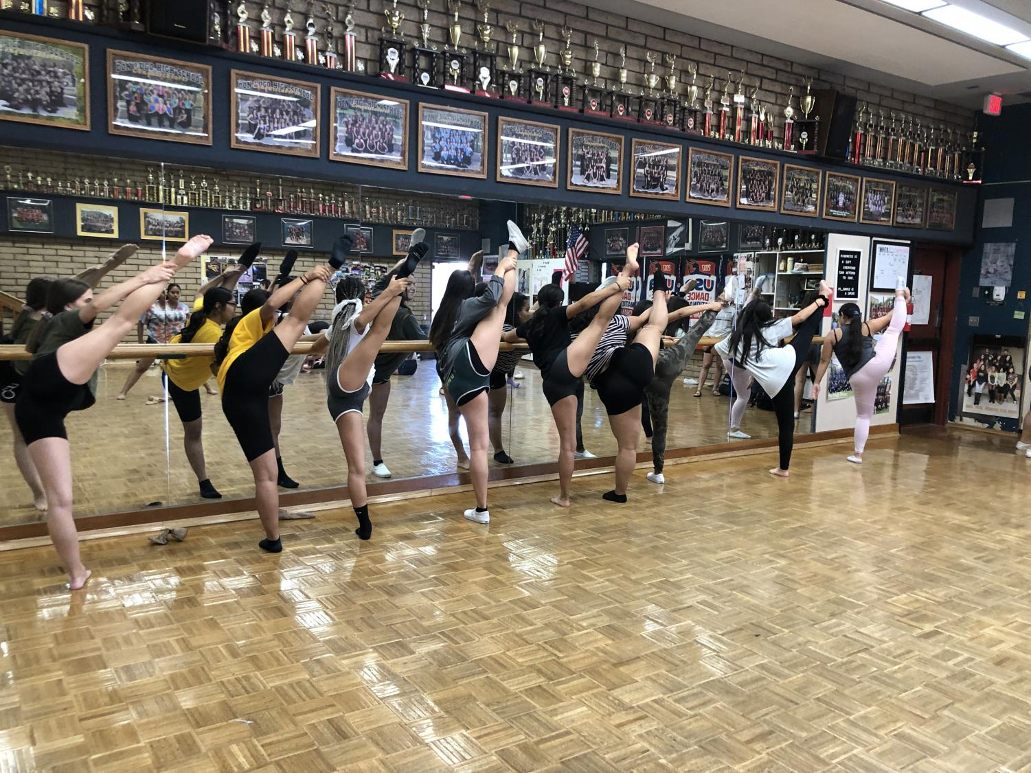 Dance team members practice their technique after school in the dance room. The dancers prepare for their homecoming performance that was choreographed by all the team members.
