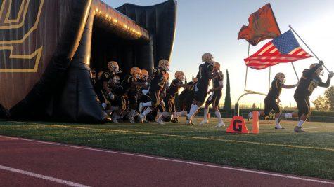 Don Lugo football team running onto field. (Photo Courtesy of: Diego Cruz)