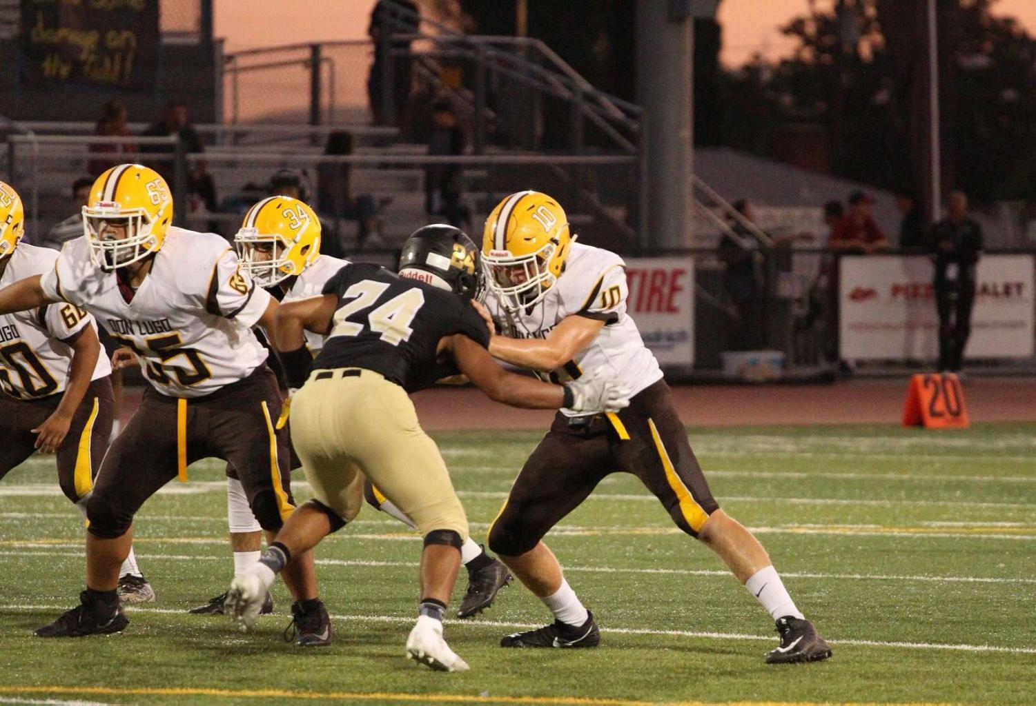 Stephen Cabrera (#10) doing his job as a Defensive Lineman. (Anthony Luna)