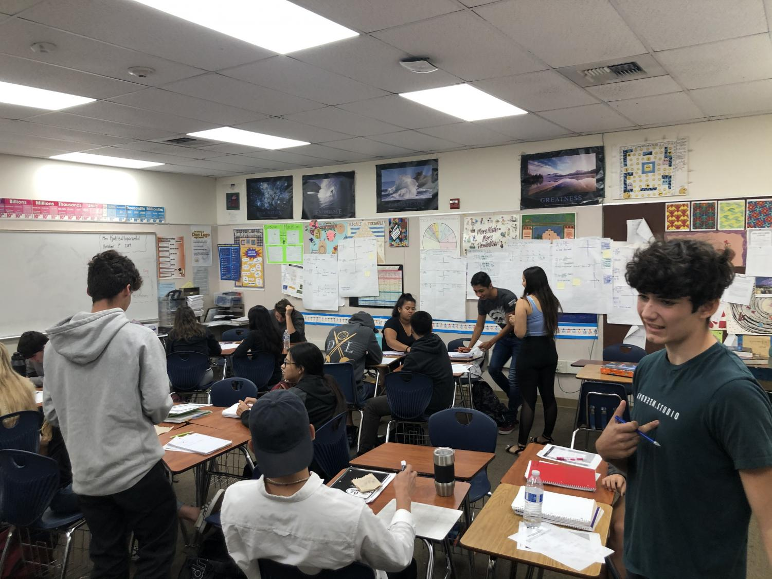 """Students are collaborating in Mrs. K's class, ensuring theirs questions are answered. Although this is important, a vital part of liking math is having a positive teacher. According to Oxford Learning, """" If a teacher is excited and positive about math, the students will be as well. But if educators are negative about it, it can have the opposite effect."""""""