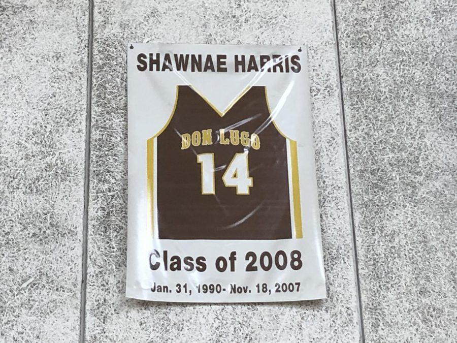 Varsity Girl basketball athlete, Shawnae Harris has jersey retired on the wall of Don Lugo's gym.