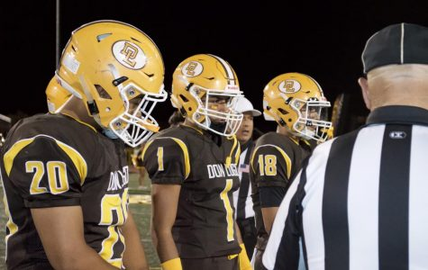 Don Lugo football captains during coin toss before game.