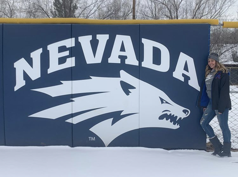 Ellie+Visits+the+University+of+Nevada.+Ellie+Garcia+stands+in+front+of+the+centerfield+logo+of+the+softball+field.