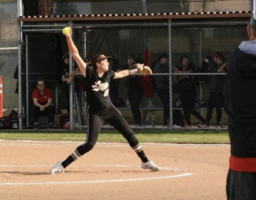 Ellie Throws Record-Setting Game against Ontario. Ellie Garcia winding up pitch against Ontario High School.