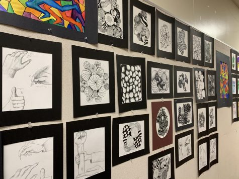 The wall of art pieces made by Ms. Lee's advanced art students during their first semester. Showing that the beauty of art is unparalleled and truly important.