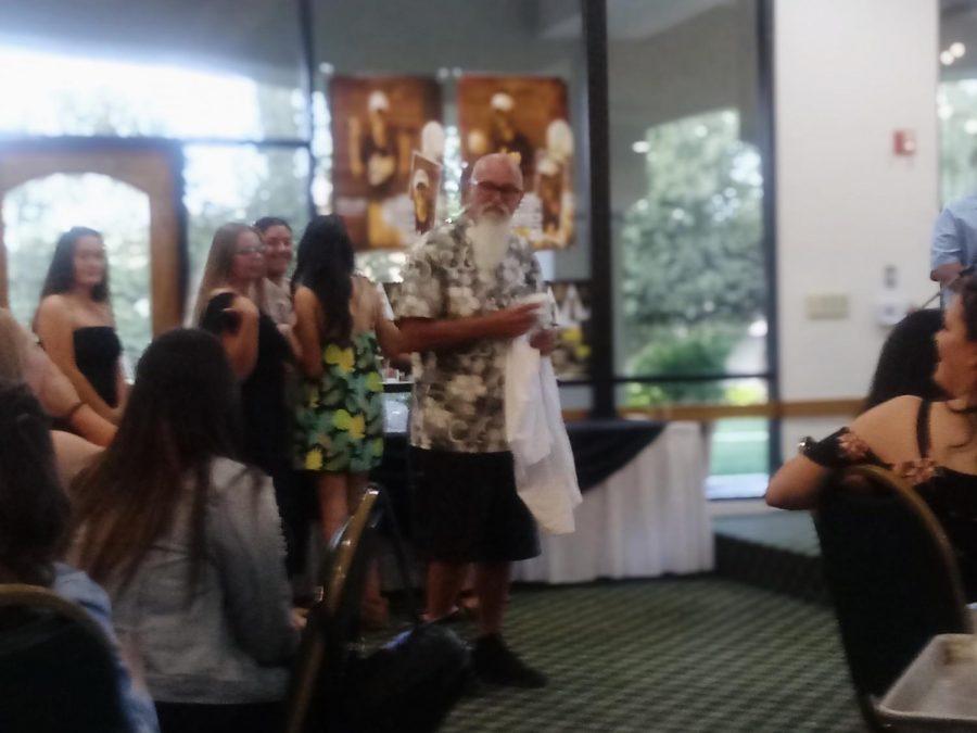 Hank receiving own softball jersey during Don Lugo softball's 2018 banquet.
