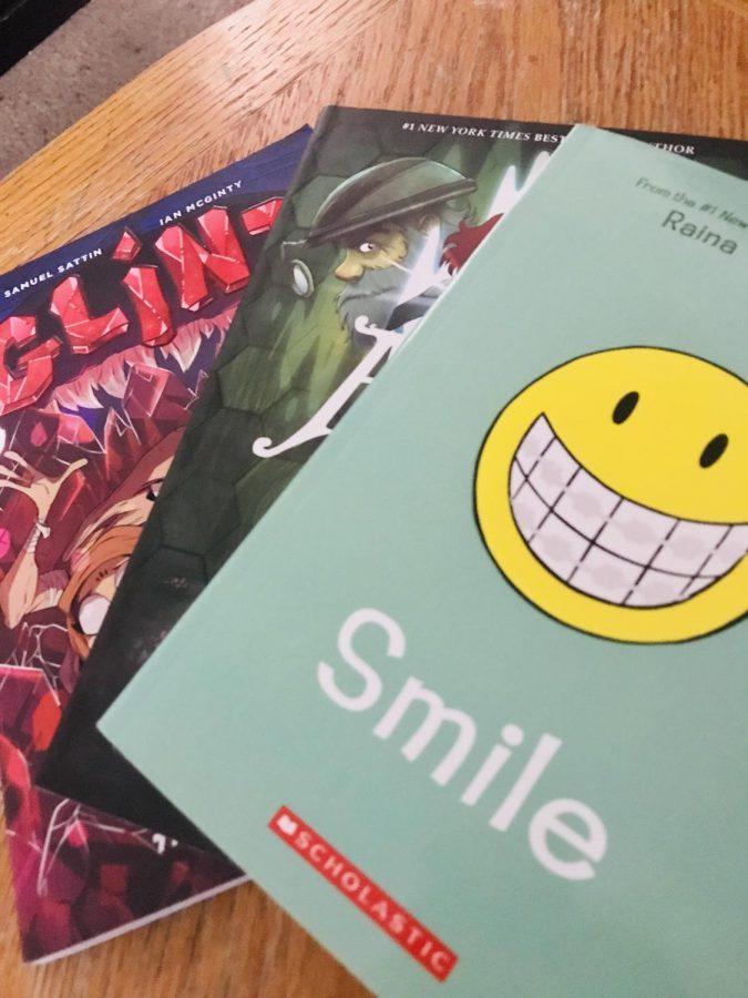 Three graphic novels: Smile by Raina Telgemeier, Amulet by  Kazu Kibuishi, and Glint by Samuel Sattin.
