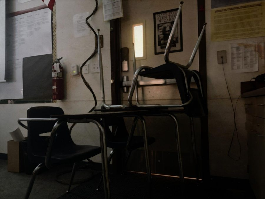 Chairs stacked in front of a classroom door as to mimic preparations during a lockdown.