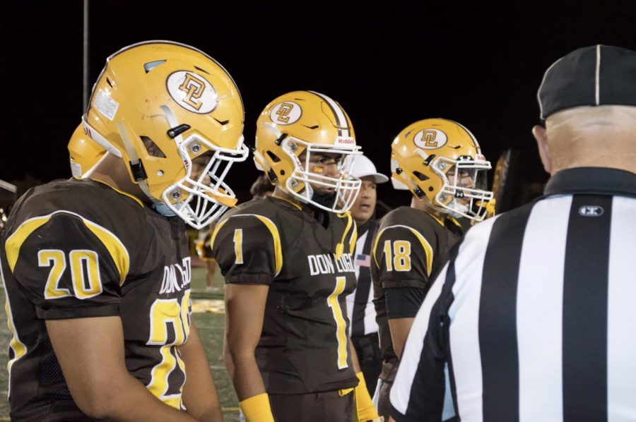 Don Lugo Varsity Captains are seen here calling the infamous coin toss. They decide to either start the kick off or pick which side they want to start on first. It's what raises the tension in the biggest game of the year.