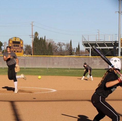 Pitcher, Ellie Garcia pitching in preseason match against El Rancho high school on February 15, 2020.