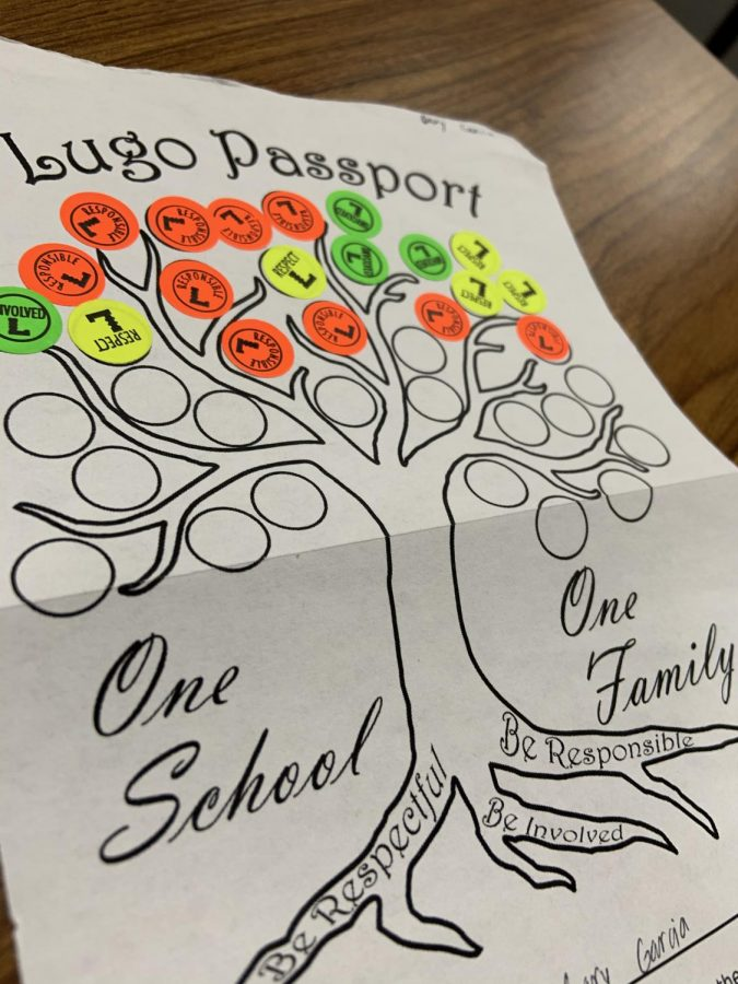 Don Lugo passport handed out to every student for a chance to win cool prizes when all coin slots are filled.
