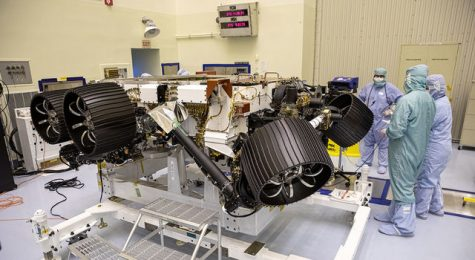 NASA's Mars 2020 rover, now called Perseverance, undergoes processing at a payload servicing facility at NASA's Kennedy Space Center as plans to launch the July mission are still on track.