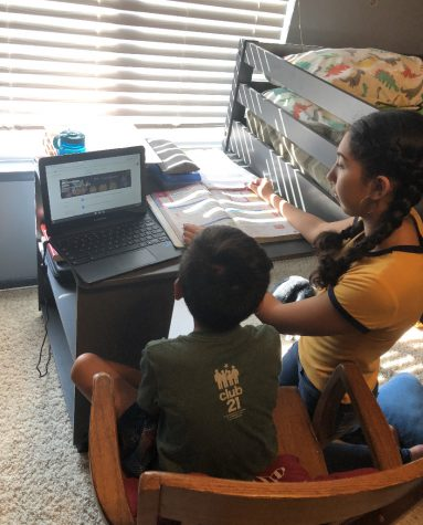 Jazmine Coto helping her brother(3rd grader) with online learning. (Photo Courtesy: Jazmine Coto)