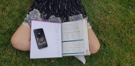 A student is doing homework while listening to music. (Photo courtesy: Megan Robinson).
