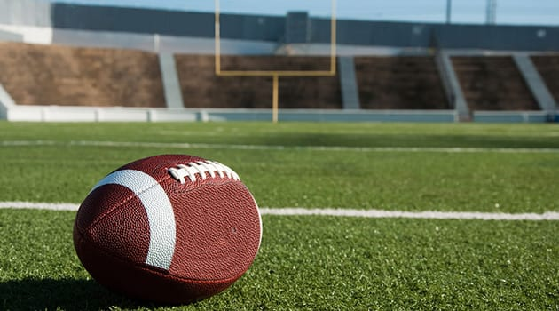 Picture football inside of an empty football field during COVID-19 outbreak. (Photo courtesy of pexels.com)