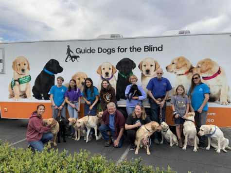 Guide Dogs For the Blind puppy trainers take picture in front of departure truck. (Photo Courtesy of Diego Cruz)