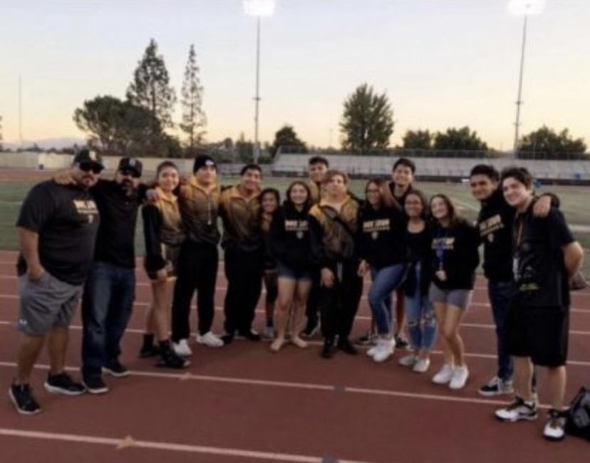 Don Lugo wrestling team gathered around track field. (Photo Courtesy of donlugowrestling)