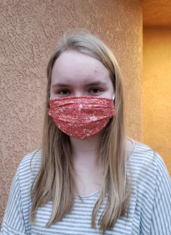 Freshman student Katelyn Robinson expresses herself with a floral patterned mask.