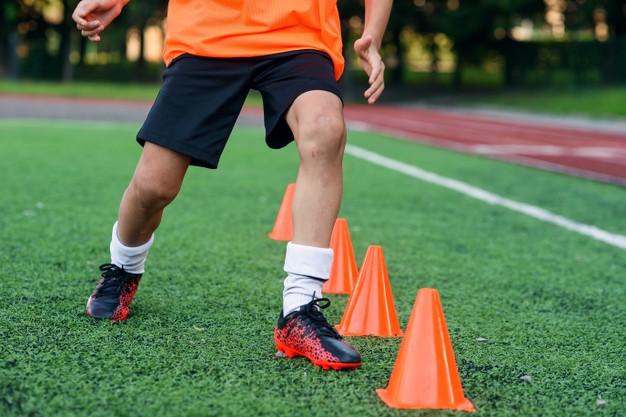 Close-up+shot+of+soccer+player+dribbling+through+cones.+%28Photo+courtesy+of+Pixabay.com%29