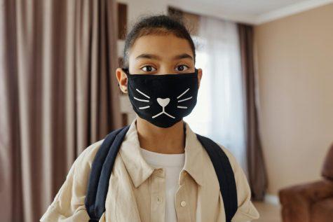 A child rocks a stylish mask to school. (Pixels.com)