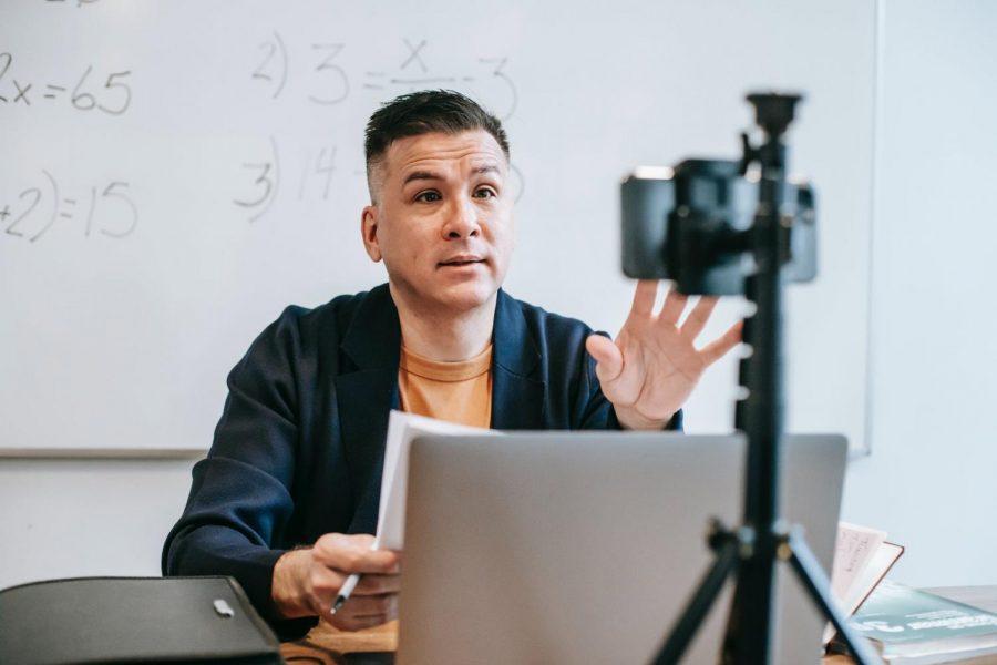 A math teacher is teaching his students math through zoom. (Photo Courtesy: Pexels.com)