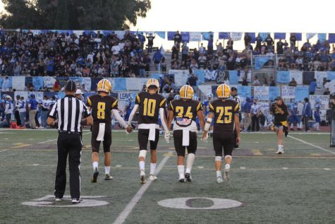 Don Lugos football team walks hand in hand as they prepare to play Chino High School in our rival game, Milkcan. Though they did not win, they used what they had been practicing and gave it their all.