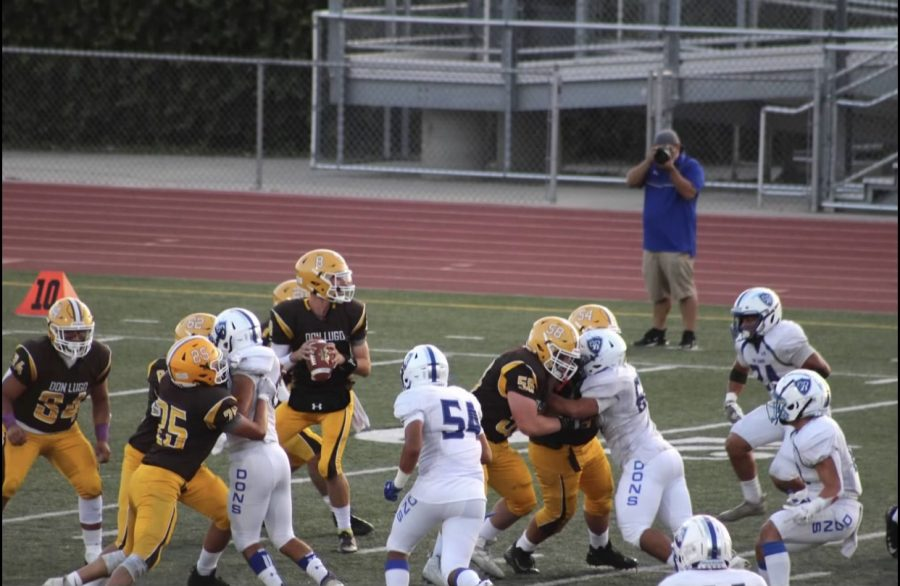 Don Lugo Football facing El Rancho. In the picture Dylan Young is sitting in the pocket during a pass play trying to find someone that is open.