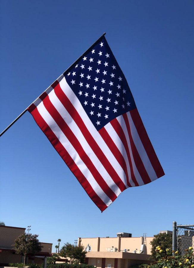 The+American+flag+waving+above+the+Don+Lugo+campus+with+clear+blue+skies+behind+it.+%22I+saw+America+stand+strong+through+our+Leadership%2C+Armed+Services%2C+and+the+American+people+coming+together+with+a+sense+of+unspoken+understanding+and+pride+of+being+an+American%2C%22+said+Ms.+Celaya+the+Digital+Media+and+Digital+Photography+Teacher+at+Don+Lugo