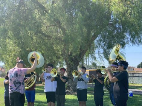 Band instructor, Mr. Yanik leads band students in breathing and marching exercises. We work hard and move forward to bring our best, said Mr. Yanik.