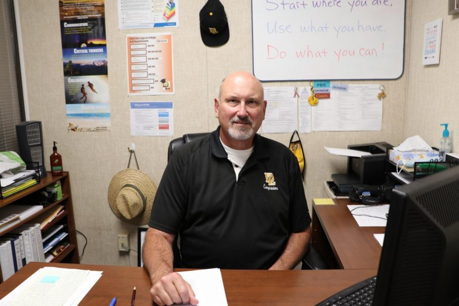 Mr. Finch sitting at his desk in the counselors office.