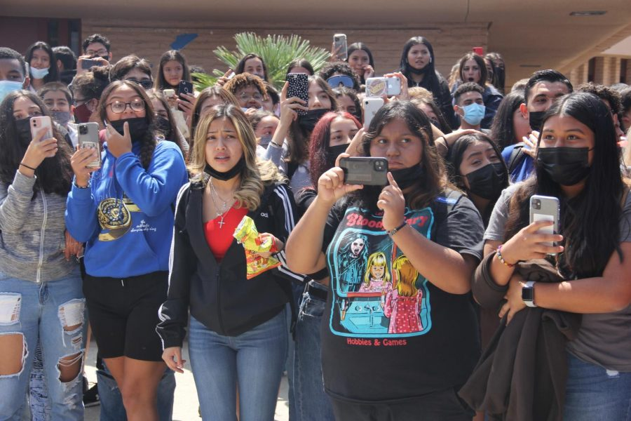 Don Lugo students crowd the protesters in the quad while they are seen recording the protest.