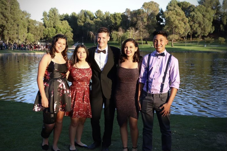 At+the+last+homecoming+dance+before+Covid-19+hit+a+group+of+sophomores+take+pictures+at+a+park.+Arianna+Hernandez+says%2C+Im+most+excited+about+getting+to+hang+out+with+my+friends+all+night+and+getting+to+take+pictures+with+them%2C+and+finally+be+able+to+go+to+the+dance+again%21