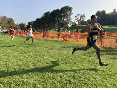 Robbie Valdez taking the run smoothly through the start. Cross country continues to push through the race coming in with a win. At this point its not really going for medals. Its going for time, stated by Robbie Valdez.
